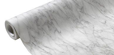 Le papier peint vinyle sur intissé Marbre blanc gris brillant habille vos murs avec chic !