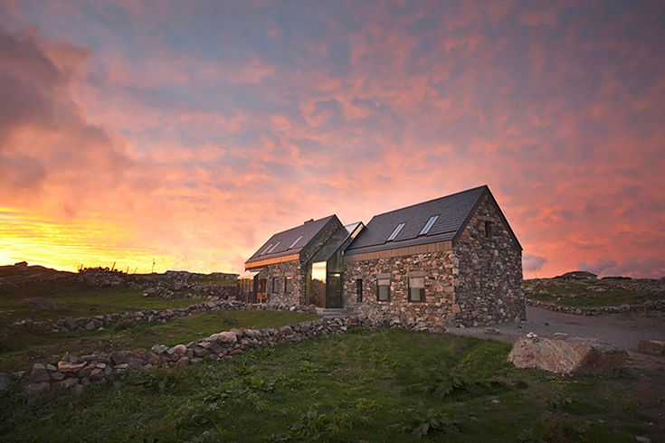 pair of restored irish cottages linked by a glass room