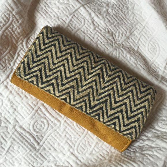 TOMS Chevron Summer Wallet This is a beautiful JOYN TOMS brand wallet. Chevron cloth material and yellow leather. Tons of space for cards and change! Lightly used. TOMS Bags Wallets