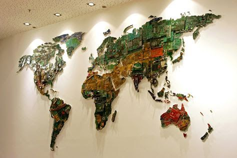 Computer parts world map. World is a giant world map made from recycled computer parts commissioned by the University of Bedfordshire. What began in 2010 is now completed with motherboards, electrical wiring, fans and other components donated by the people at Secure IT Recycling. Many of her works, including this one, are concerned with issues of ecology, geo-politics, mapping, trade and global commerce.