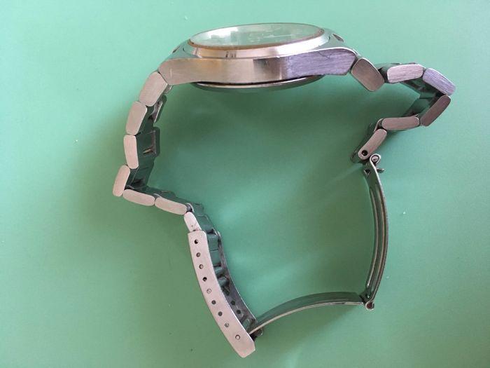 Omega Seamaster Cosmic 2000 - Herenhorloge  38mm excl opwindkroon 41mm met kroon. De bandlengte is 23cmDe horloge is van de jaren 70 en loopt goed met kleine afwijking kan mogelijk een onderhoud gebruiken. De band heeft wat stretch zie foto's voor beter inzicht hierover.Echter geen papieren nog doos.Verzekerde verzending.  EUR 0.00  Meer informatie  #watch
