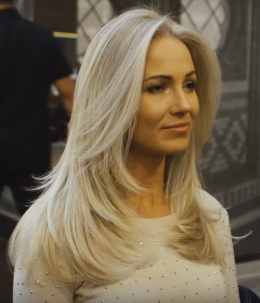 Long layered haircut with highlighting by Adam & Michelle Ciaccia