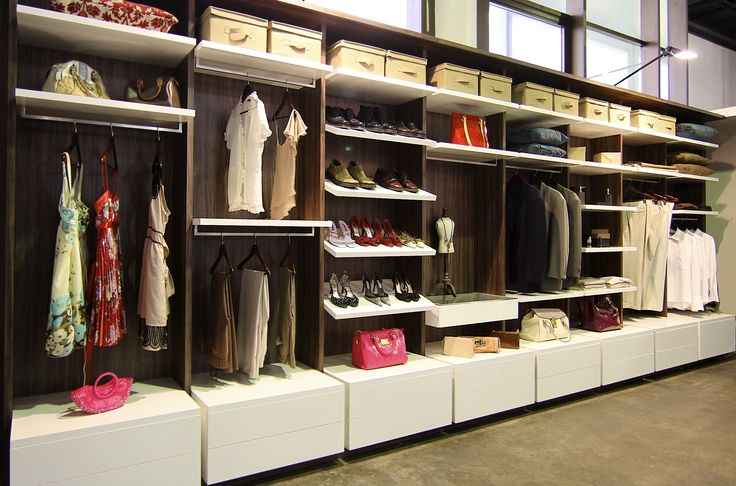 Just Wardrobes boutique robe design, a suspended look with push to open lower drawers topped with stunning shelving and hanging solutions. Recessed gables really make the robe pop.