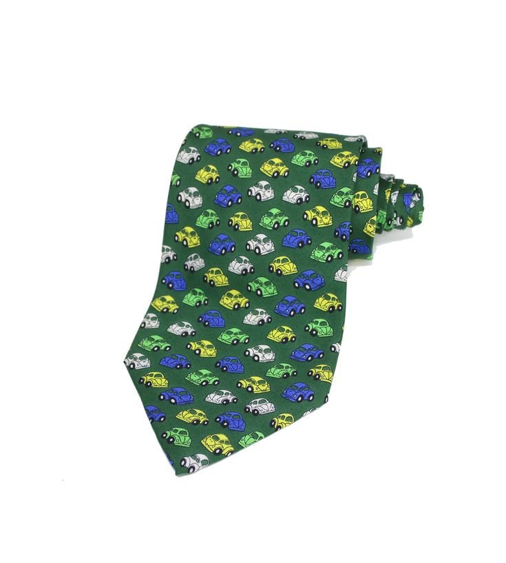 A unique vintage silk tie from Chez Roger Design. Vintage Volkswagen Beetle pattern in yellow, blue, white, and green colors. 100% silk. Made in Italy Length: 151cm. Width: 9.5cm.
