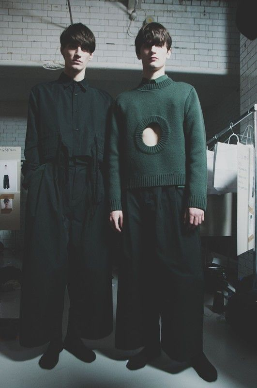 Keyhole sweater in bottle green backstage at Craig Green AW15 LCM. See more here: http://www.dazeddigital.com/fashion/article/23182/1/craig-green-aw15