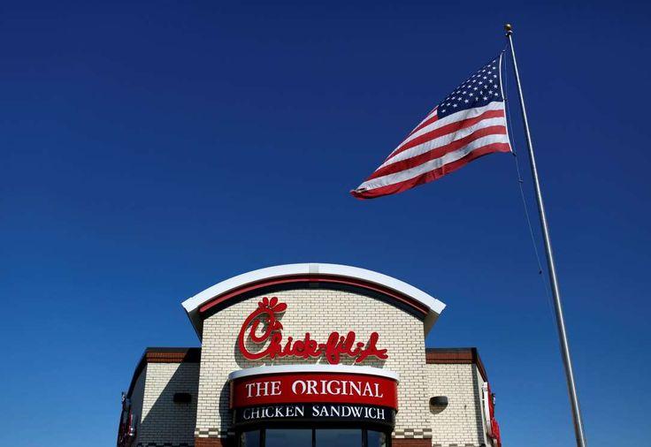 A U.S. flag flies outside a Chick-fil-A Inc. restaurant. - Luke Sharrett/Bloomberg