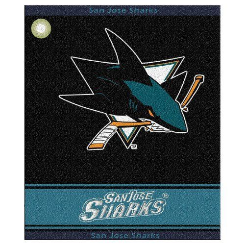 """NHL San Jose Sharks Woven Towel by Team Golf. $16.99. 100-Percent cotton. Includes corner hook for easy attachment to the golf bag. 16"""" x 19"""" woven golf towel. Top and bottom hem includes school name. 16"""" x 19"""" 100-Percent cotton towel includes woven school logo and name, along with top and bottom double jacquard hems with full team name."""