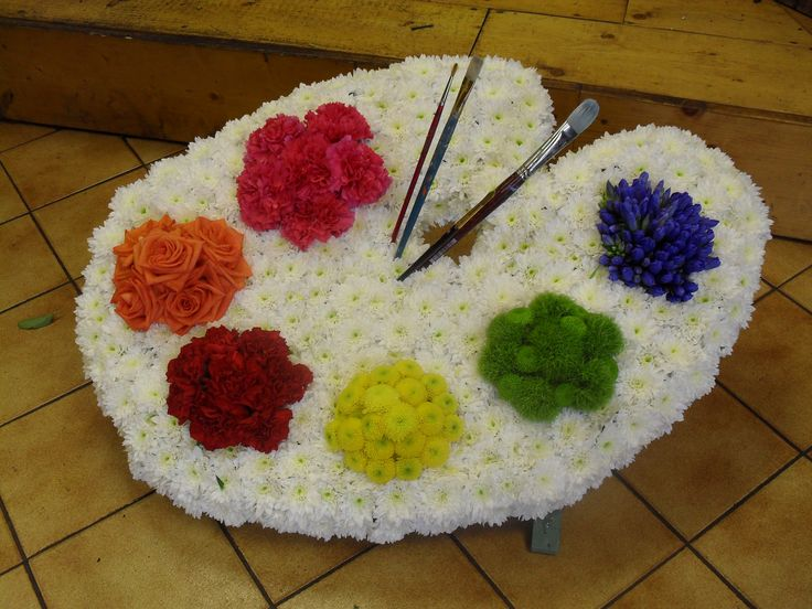 an artist's palette funeral tribute. created by Dilly at The Rosebud.