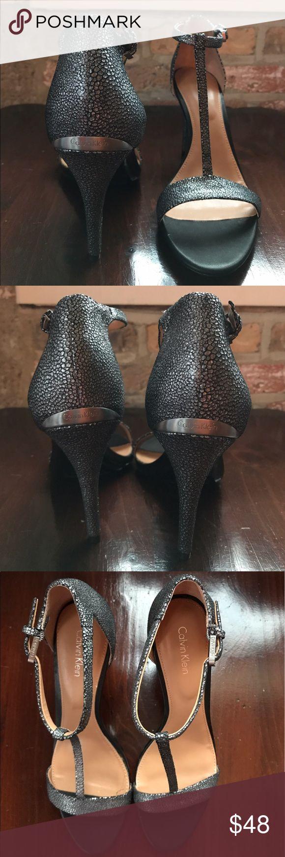 Calvin Klein Heels Sleek Calvin Klein dress sandals. Round toe ankle strap sandals. Adjustable buckle closure. Speckle-like design in silver. 3.75 inch heels. NEVER WORN. Calvin Klein Shoes Heels