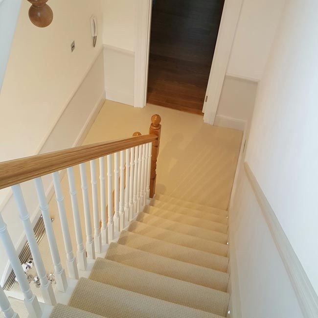 White Carpet to Stairs with Silver Stair Rods