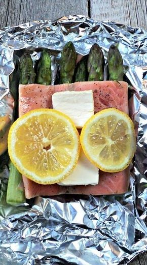 Easy 239 calorie baked salmon recipe with asparagus 4 Salmon Fillets, 3 Lemons, 2 tbsp. Cold Butter (cut into 8 pats of butter), 1.5 lb Asparagus (you will only use the tops), Sea Salt (to taste), Pepper (to taste)