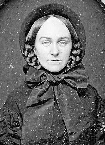 Young lady. Hairstyle described in Godeys Magazine, early 1860s.   did ya notice she has no decoration on her bonnet. none!