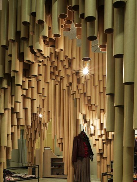 I love how the tubes have been suspended from the ceilings and how they're used for an unusual method of division of space. Clever! | #Cardboard Tubes | The Resource Exchange