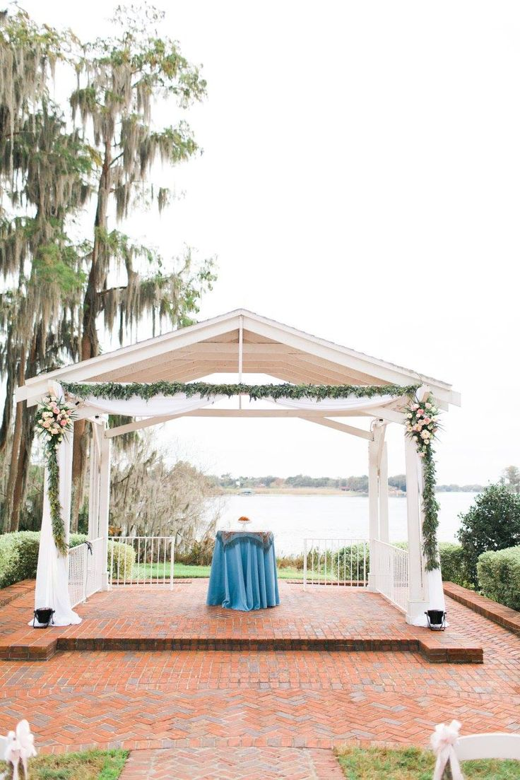 Photographer- Andi Mans, Venue- Cypress Grove Estate on Lake Jessamine. Dusty misty slate blue and rose quartz pink wedding