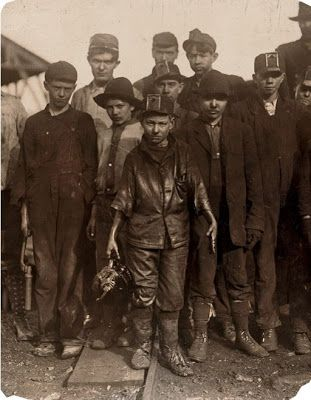 Boys from the Coal mines in the Welsh valleys. THEY WERE NOT EMPLOYED BUT ENSLAVED BY THE SAME GREED WHICH SEEKS TO ENSLAVE US ALL!!! JUST THINK ABOUT IT, WHAT ARE YOU IN THE UK WORKING TOWARDS-I'LL TELL YOU-TO MAKE THE RICH RICHER AND MORE POWERFULL-WHAT ARE THEY GIVING US IN RETURN-THEY ARE STRIPPING US OF OUR RIGHTS AND FREEDOM WHICH IS ALL WE WILL EVER GET FROM THEM AND NOW THEY HAVE DRAGGED US INTO ANOTHER WAR-LIKE IT OR NOT THIS IS THE REALITY OF LIFE IN THE UK!!!