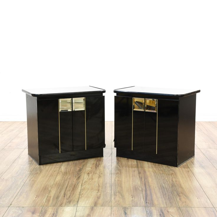 This pair of contemporary art deco inspired nightstands are featured in a solid wood with a glossy black lacquered finish. These end tables have 2 mirror front doors with large interior cabinets and inset bases. Sleek bed side tables perfect for a modern bedroom! #contemporary #dressers #nightstand #sandiegovintage #vintagefurniture