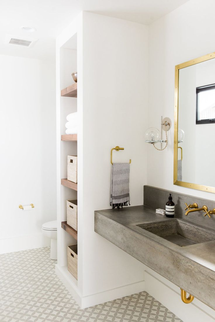 modern white and gray bathroom with cement counter, mixed metals and patterned cement tile floor  Interior Design : Studio McGee | Photography : Travis J Photography Read More on SMP: http://www.stylemepretty.com/living/2016/08/12/get-the-inside-scoop-on-patterned-tile-from-this-interior-design-pro/