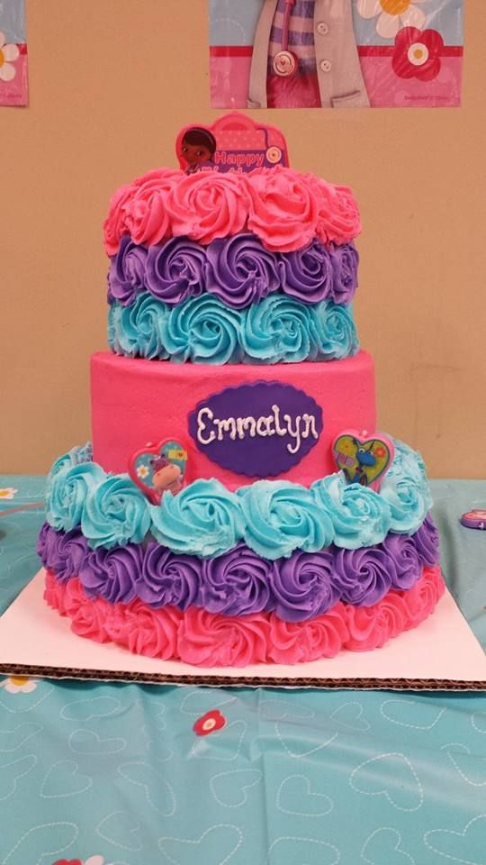 Rosette tiered birthday cake for a Doc McStuffins party~