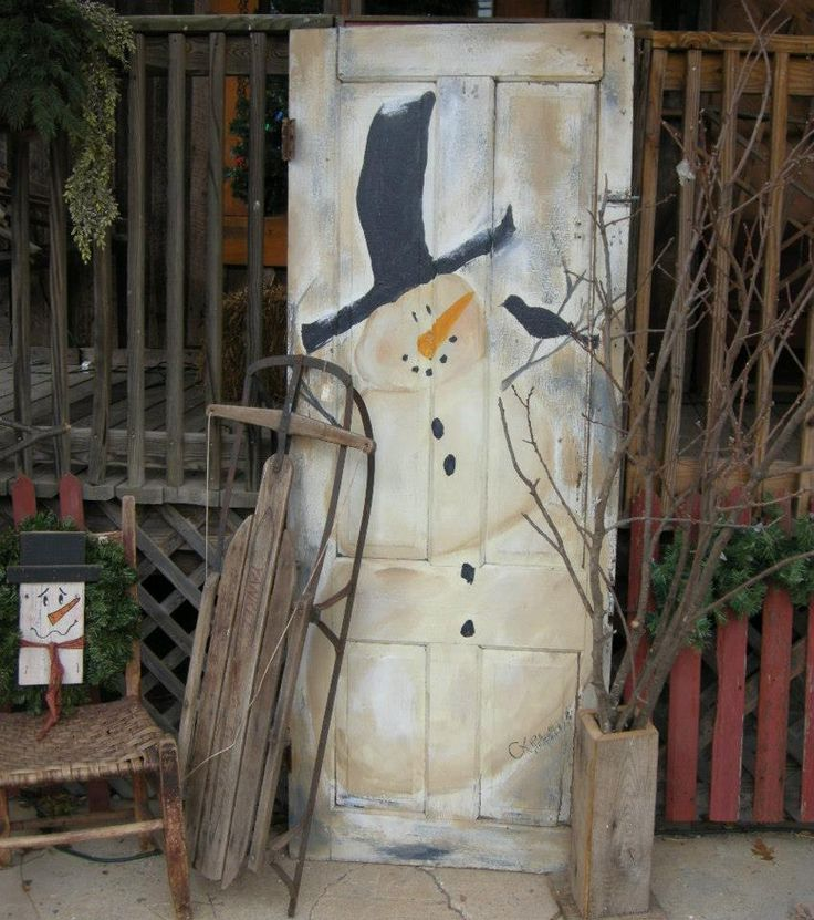 snowman painted on old door, love the hat!