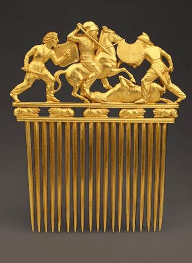 Comb   Solokaha Barrow, 4th century BC    In composition this comb, which was found during the excavations of Solokha Barrow, recalls the facade of a Greek temple with a colonnade made up of its 12 teeth, a triangular fronton with three battling warriors, and a frieze of five reclining lions.