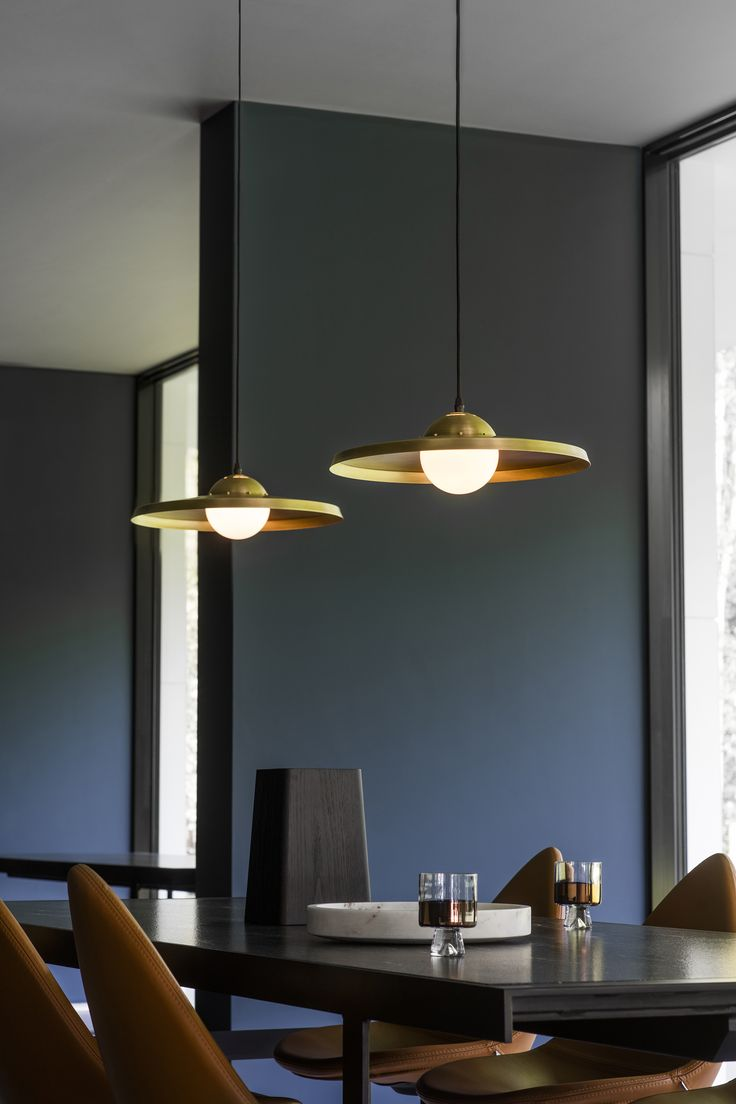 Price above excludes VAT  With a simple and sleek spun brass shade, the Sedge Pendant Lamp is  finished by hand with understated brass industrial-inspired fixing details  and a single central opal globe.  Specification:  H:130mm W:420mm D:420mm