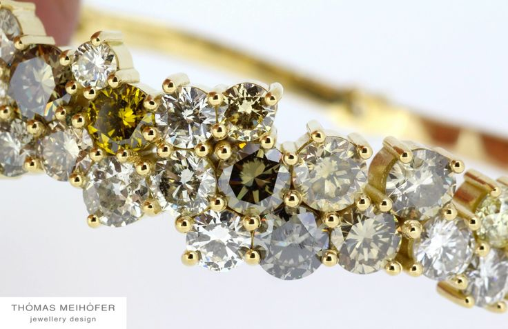 18ct yellow gold and fancy diamond bangle.