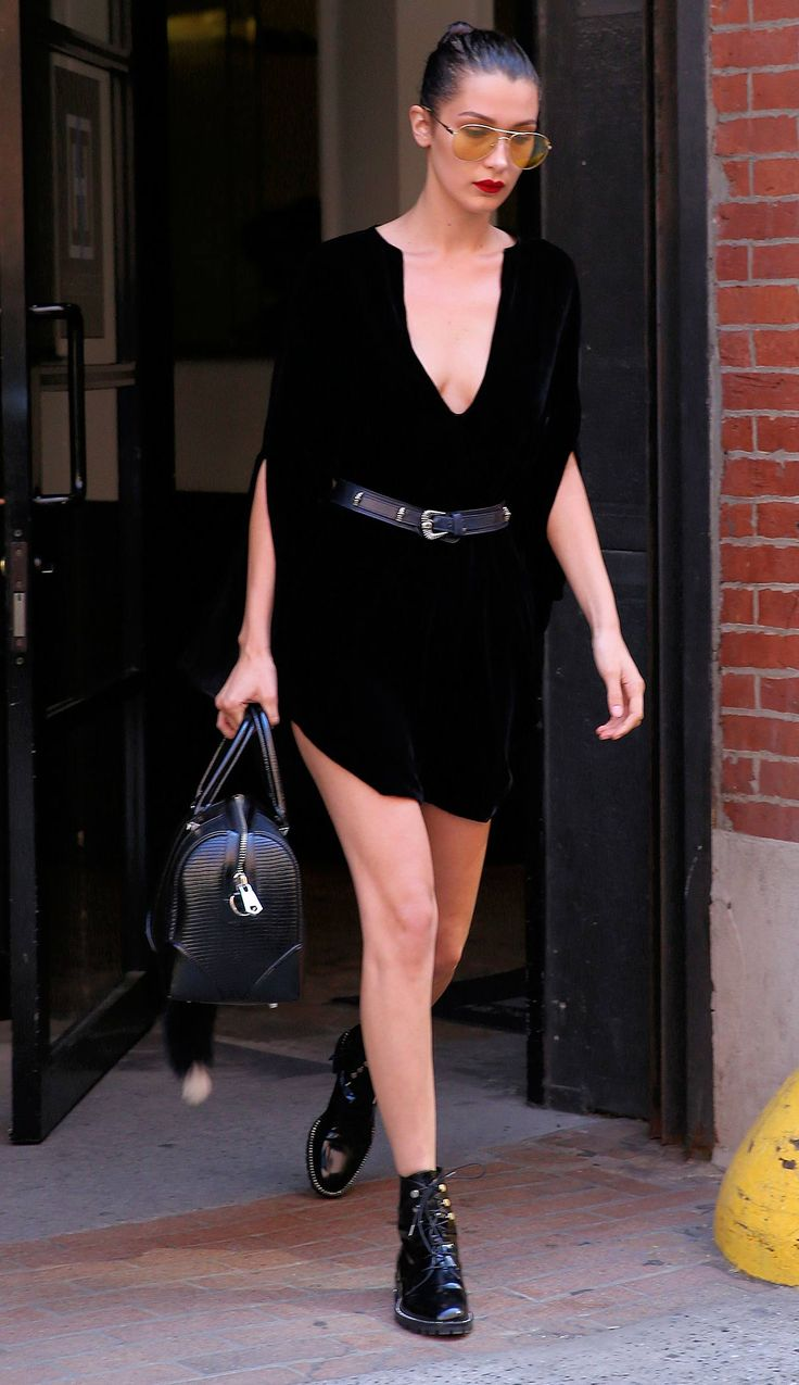 Bella Hadid out in New York wearing all-black with just a *touch* of colour, via her yellow-tinted aviator sunglasses.