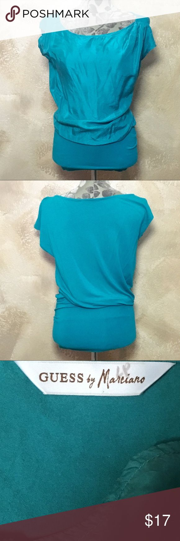 Guess Marciano Green Silky-Front Long Tunic Guess Marciano Green Silky-Front Long Tunic  Size: XS - Could fit S/M Measurements can be provided upon request   Fabric Content  95% Rayon 5% Spandex  Features ✨ •Comfortable, soft, and stretchy  •Quality material that's made to last •Elastic thick hem •Silk-like front   •EUC  Get 15% off when you buy 3+ items plus save on shipping!  Thanks for looking  Guess by Marciano Tops Tunics