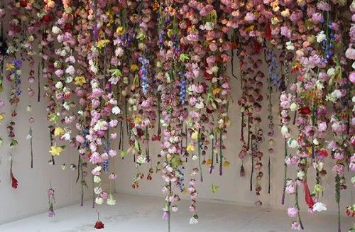 Flower installation - florals fall from the ceiling. Arty by Rebecca Louise Law on Design*Sponge - creativity inspired by #flowers.