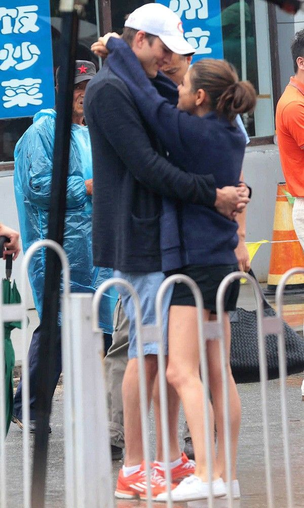Ashton Kutcher and Mila Kunis looking loved-up in Beijing