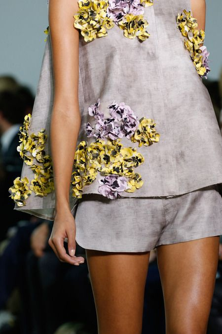 Style.com. Giambattista Valli Spring 2014 Ready-to-Wear Collection: two-piece shorts and top in gray with yellow and purple embrodiered details