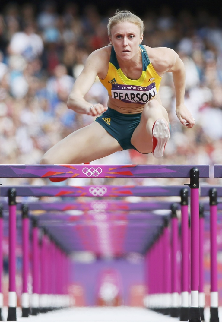 Australia's Sally Pearson competes during her women's 100m hurdles round 1 heat during the London 2012