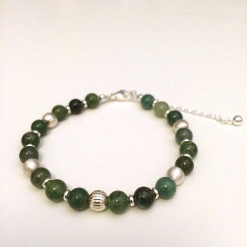 Handmade bracelet with Green Moss Agate gemstone beads and 925 sterling silver beads and details (300.00 SEK) by Penello