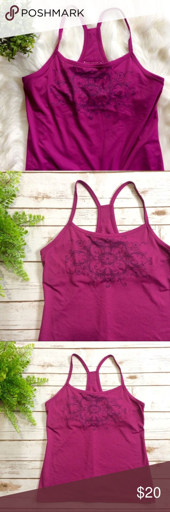 Yoga Spaghetti Strap Tank Top This gorgeous purple/magenta color top will pair perfectly with solid color workout clothes for a fun pop of color! Perfect for the gym or lounging. Features a racer back style straps and a fully lined shelf bra. 90% polyester, 10% spandex tek gear Tops Tank Tops