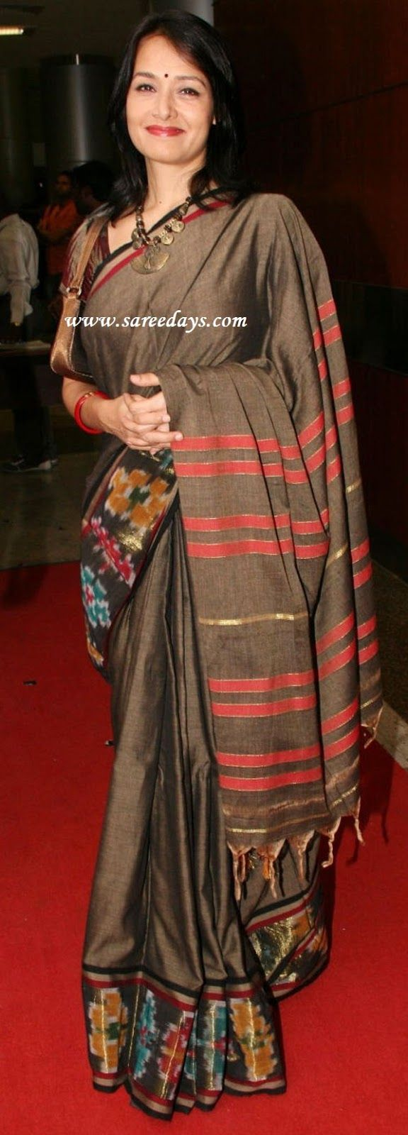 Amala in traditional silk sari