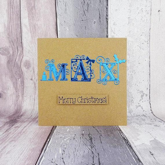 This special font handmade Christmas card is personalised with a three letter name and you can choose the colour of the foiled card that spells out the name, which is Max on the one shown. This would be a lovely custom card for a boyfriend, girlfriend, or a special friend.  Please add the name you would like on the card in the Note to seller section at checkout.  The letters in this alphabet has swirls, stars, a Christmas candle, an elf hat, holly and berries and other Christmas icons…