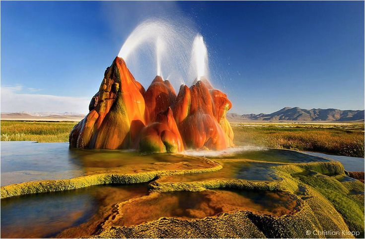 Fly Geyser, Nevada~~ Fly Geyser was accidentally created when a well was drilled and left uncapped. Minerals and algae started to rise from the geyser and accumulated to form an alien-like mound.