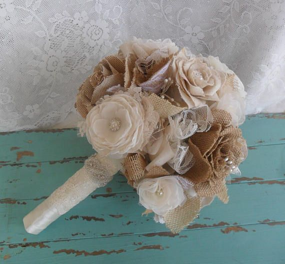 This stunning one of a kind burlap and lace bouquet (with matching boutonniere) will add that special touch to your rustic, outdoor, country, vintage or shabby chic wedding. Bouquet is made with handmade burlap, chiffon and lace flowers that are accented with pearls and rhinestones,