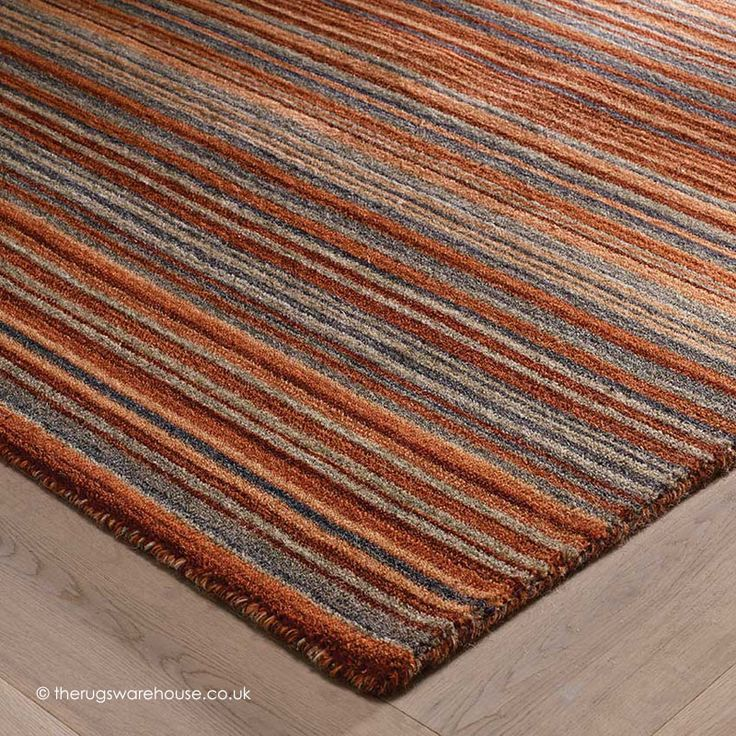 Carter Rust Rug Texture Close Up A Modern Striped Design In Warm