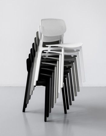 Stackable chair for indoor or outdoor use. Lacquered aluminium frame, with injection-moulded polypropylene seat and back. Available in the following colours: white, black, beige, coral red and basalt grey.