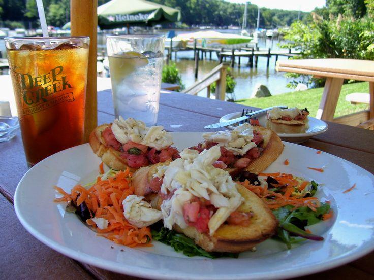 Enjoy jumbo lump crab bruschetta and refreshing beverage while overlooking the marina at Deep Creek Restaurant in Arnold, MD.