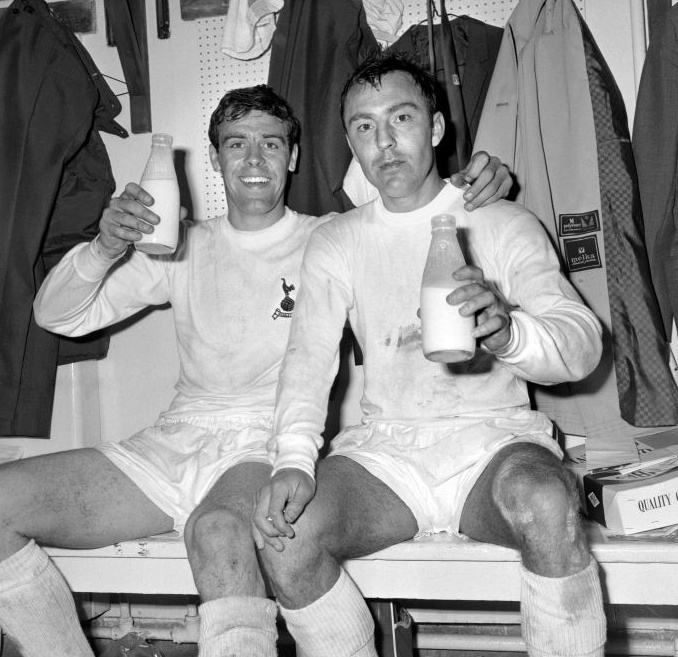 Mike England (Tottenham Hotspur FC, 1966–1975, 300 apps, 14 goals) and James 'Jimmy' Greaves (Tottenham Hotspur FC) after the 1967 FA Cup Final, celebrating Tottenham's win over Chelsea with a couple of pints of milk.