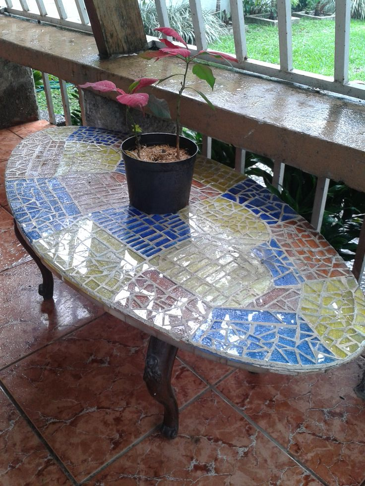 Glass mosaic on Onyx stone table.
