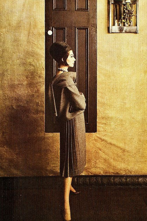 1960 - Simone in an Yves Saint Laurent for Christian Dior two-piece dress in frosted brown wool with draped overblouse and pleated skirtby Melvin Sokolsky for Harper's Bazaar
