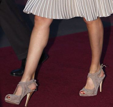 """On her feet were a """"new"""" pair of Adolfo Dominguez suede high heel shoes. These taupe suede sandals are from the Spanish designer's 2011 collection but this is the first occasion Letizia has worn them publicly. The platform heels have a ribbed suede pattern and lace closure around the back ankle."""