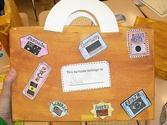 suitcase made of cereal box stores each students' unit materials during around the world unit.