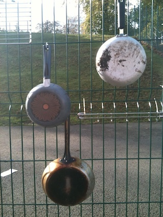 Turn old pans into outdoor instruments from: I'm a teacher, get me OUTSIDE here!: Outdoor Music Wall