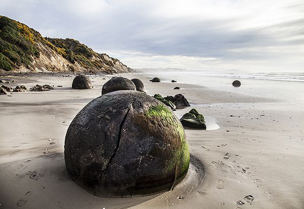 Your Shot: New Zealand -- National Geographic Travel  Moeraki Boulders The Moeraki Boulders, a natural wonder and a must-see for any travelers to New Zealand. A shame someone felt the need to leave their mark on the boulder.