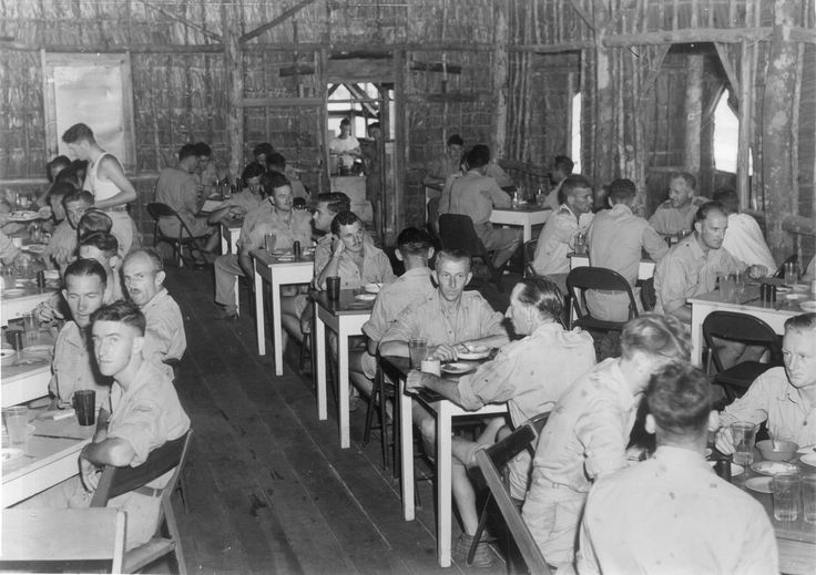 Airmen eating a meal in the mess dining room at Camp Tui, Guadalcanal, circa WWII. From the collection of the air Force Museum of New Zealand.