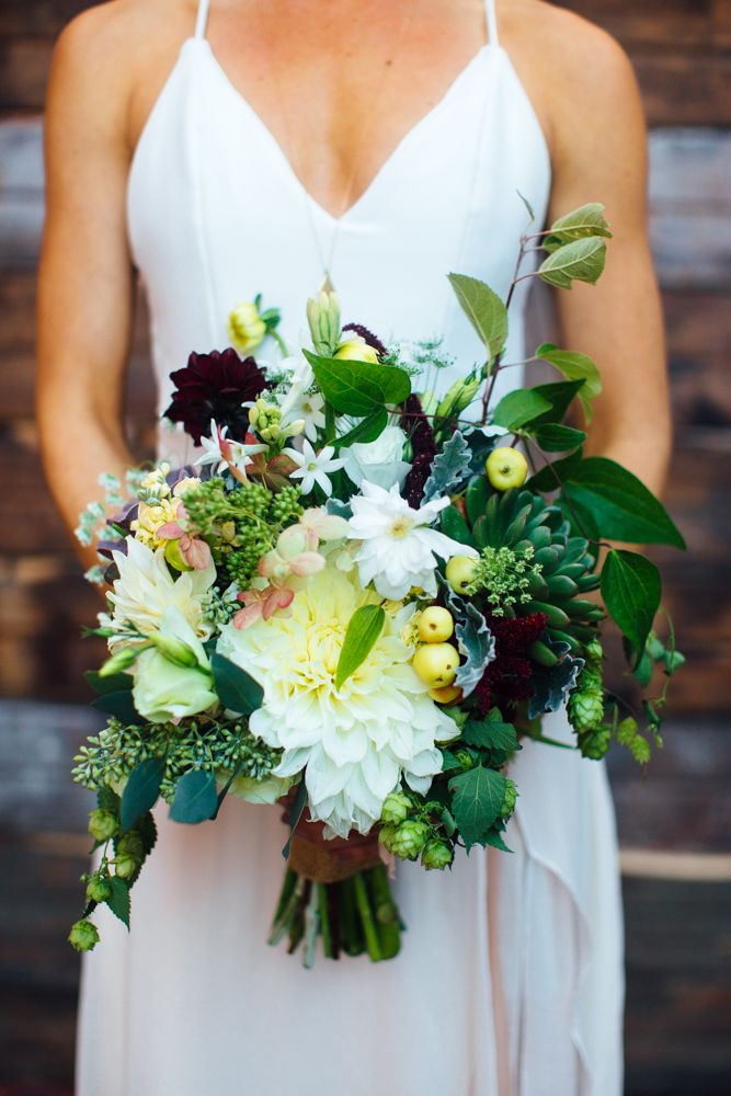 Hops, dahlias, clematis, crabapple, lisianthus, hydrangea, tuberose Bridal Bouquet designed by Sunny Meadows Flower Farm (photo by Ely Brothers)
